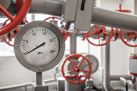 Valves and manometers on Industrial pipeline system photo