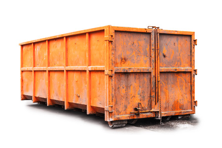 Big metal orange trash container isolated on white photo