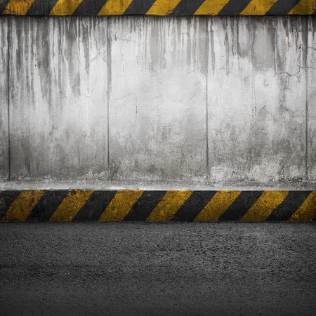 Concrete wall and asphalt. Abstract industrial interior background texture photo