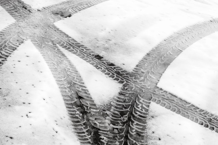 Transportation background with tire tracks on wet snow photo