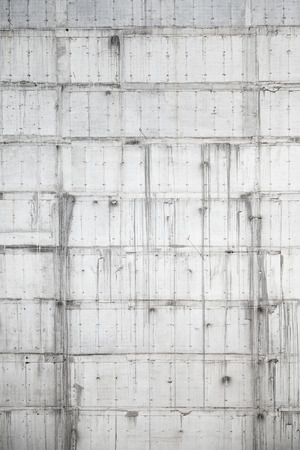 Vertical background texture of new gray concrete wall under construction photo