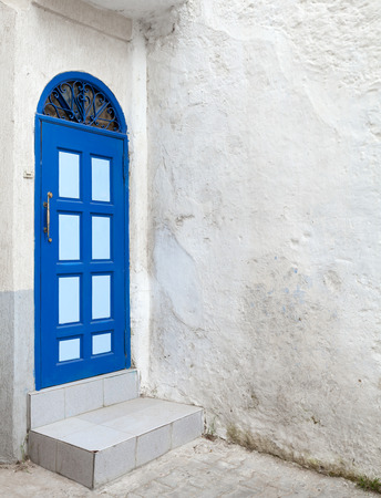 Blue door and white walls  Old Medina, historical part of Tanger city, Morocco photo