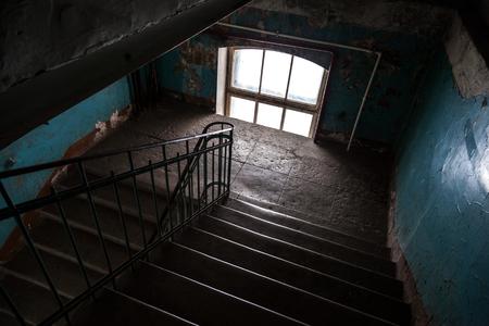 entryway: Dark abandoned stairway interior in old living house, St.Petersburg, Russia