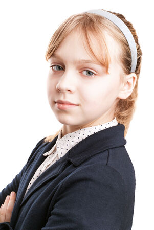 Closeup portrait of blond Caucasian schoolgirl  isolated on white  photo
