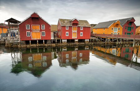 Red and yellow wooden houses in Norwegian fishing village  Rorvik, Norway photo