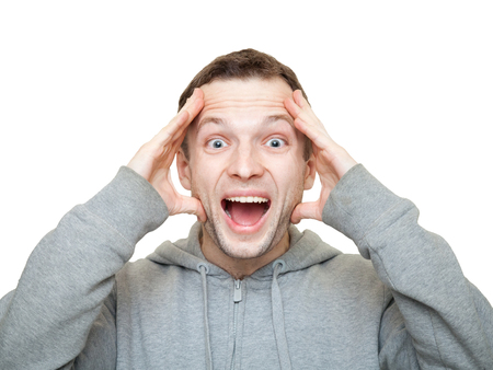 european expression face: Happy sporty young Caucasian man holds his head and laughs.