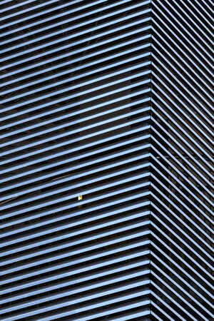 Abstract architecture background with striped metal walls photo