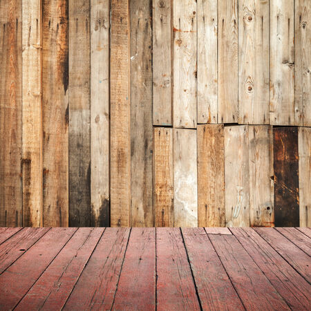 Empty grungy wooden interior background with red floor photo