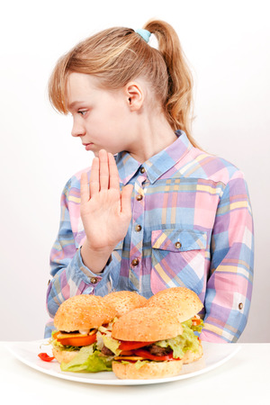 Little blond Caucasian girl saying hamburgers  No photo
