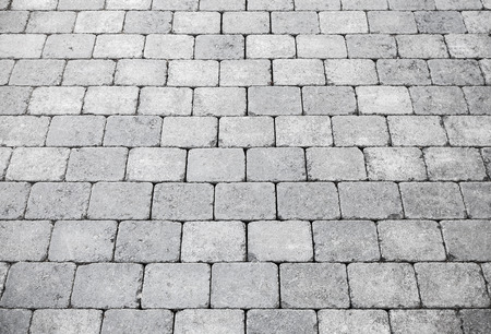 Gray brick pavement perspective, background photo texture photo