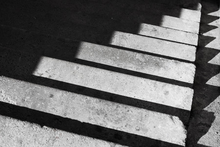 down beat: Abstract architecture background with concrete staircase and shadow