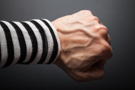 Close up photo of sailor fist  on a dark background Stok Fotoğraf