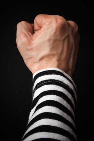 Closeup photo of sailor fist  on a dark background