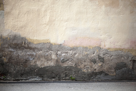 Grunge city with old wall and asphalt photo