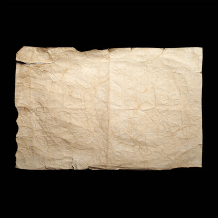 Sheet of old yellow crumpled paper isolated on black photo