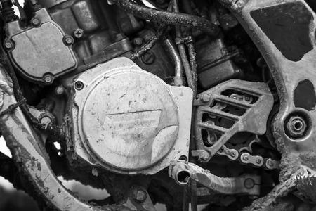 Close-up monochrome fragment of sport motocross bike engine photo