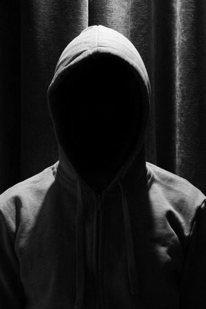 invisible: Portrait of Invisible man in the hood with curtain background Stock Photo