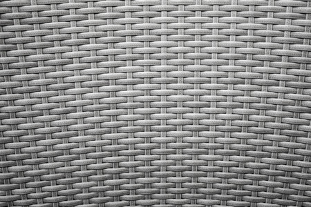 Gray wicker furniture surface  Background photo texture photo
