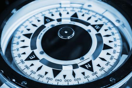 Naval compass. Blue toned monochrome macro photo photo