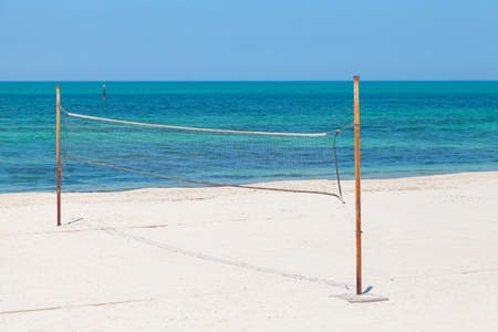 Net for beach volleyball on the sea coast photo