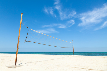 Net for beach volleyball on empty sea coast photo