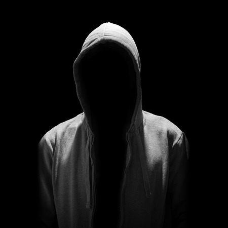 Portrait of Invisible man in the hood isolated on black background Stock Photo