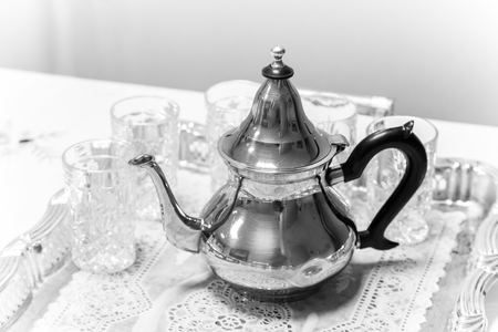 marocco: Metal Arabic teapot with glasses, black and white photo