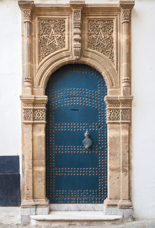 Ancient blue door with decoration  Tangier, Morocco photo