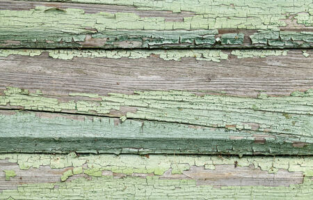 Old weathered wooden wall with cracked paint photo