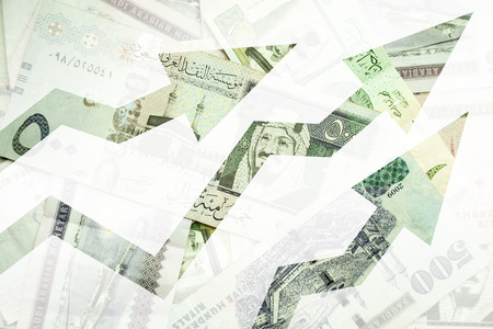 market trends: Saudi Arabia money background with growing trends arrows
