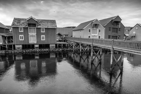 Wooden houses on the coast in Norwegian fishing village. Rorvik, Norway photo