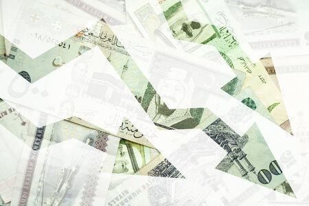 arabic currency: Saudi Arabia money background with negative trends arrows