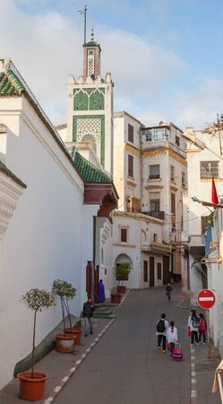 maroc: TANGIER, MOROCCO - MARCH 22, 2014: Old Medina area in Tangier, Morocco. People are walking on narrow street