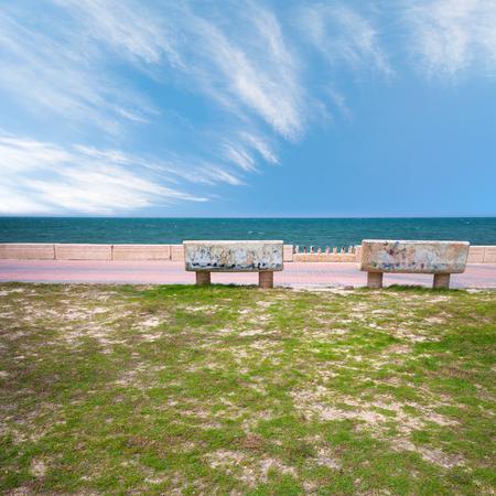 persian gulf: Two stone benches on the coast of Persian Gulf in Saudi Arabia Stock Photo