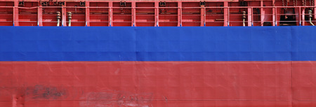 Blue and red cargo ship hull side texture photo