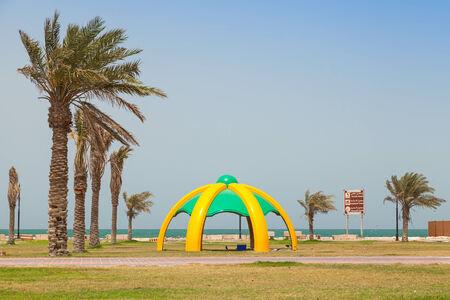 persian gulf: RAHIMA, SAUDI ARABIA - MAY 10, 2014: Palms and arbor on the coast of Persian Gulf Editorial