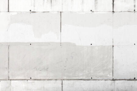 Gray wall made of concrete blocks, background texture photo