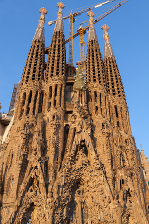 neogothic: BARCELONA, SPAIN - AUGUST 26, 2014: La Sagrada Familia, the cathedral designed by Antoni Gaudi, which is being build since 19 March 1882 and still is under construction
