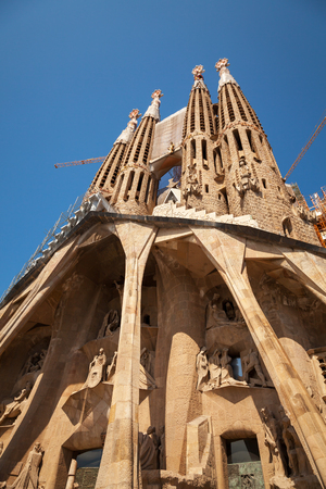 BARCELONA, SPAIN - AUGUST 27, 2014: La Sagrada Familia, the cathedral designed by Antoni Gaudi, which is being build since 19 March 1882 and still is under construction