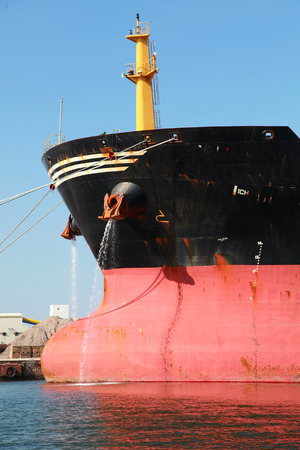 ship bow: Bow of big red industrial cargo ship Stock Photo