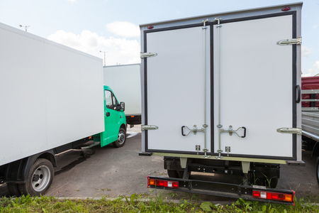 Rear view of new standing white cargo trucks  photo