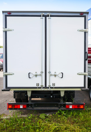Rear view of new white cargo truck photo