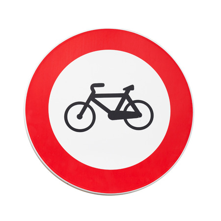 Bicycles traffic is prohibited, road sign isolated on white photo