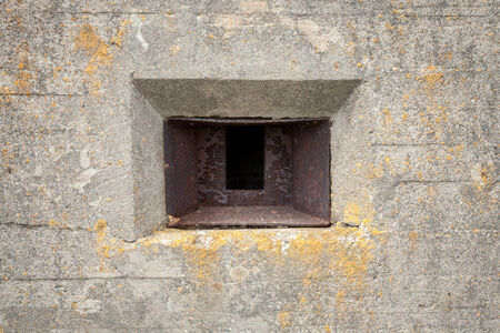 loophole: Rusted loophole in old concrete bunker wall Stock Photo