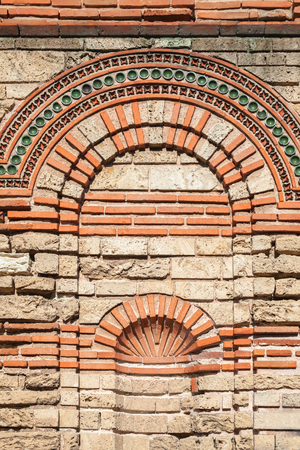 Old stone wall texture, Church in Nessebar, Bulgaria photo