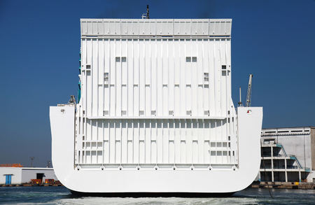 the back gate: Back gate of big white ferry in port Stock Photo