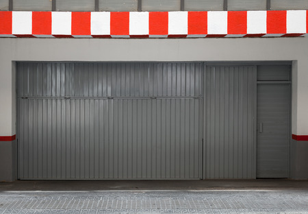 Empty urban interior with parking gate and striped border photo