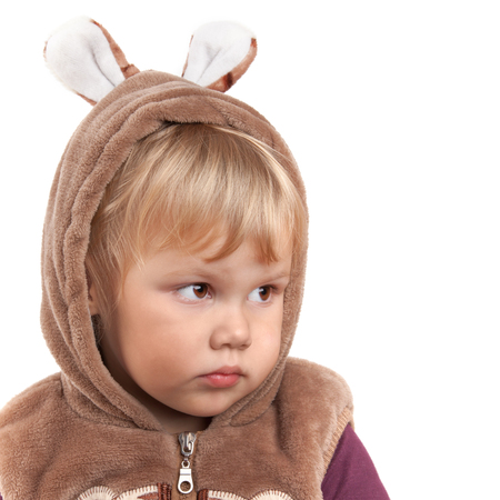 Portrait of serious Caucasian baby girl in bear costume isolated on white photo