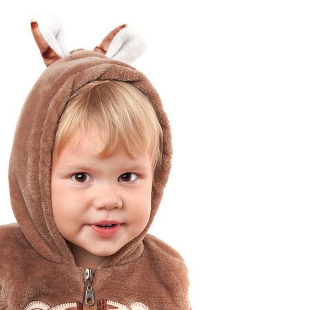 Portrait of smiling Caucasian baby girl in bear costume isolated on white photo