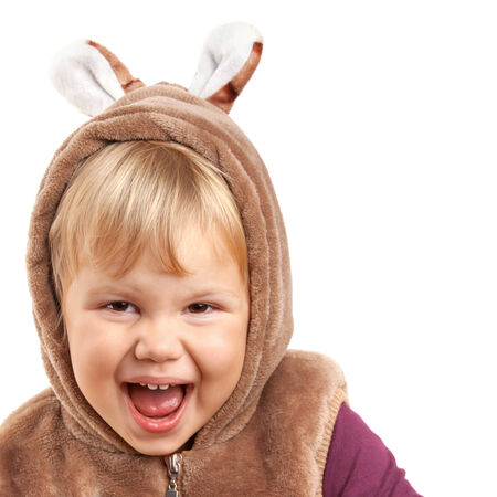 Portrait of laughing Caucasian baby girl in bear costume isolated on white photo